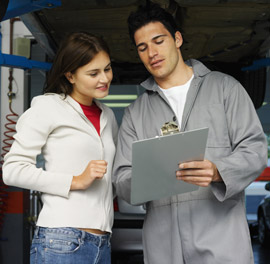 Car mechanic talking to a customer, Fishbowl Blog
